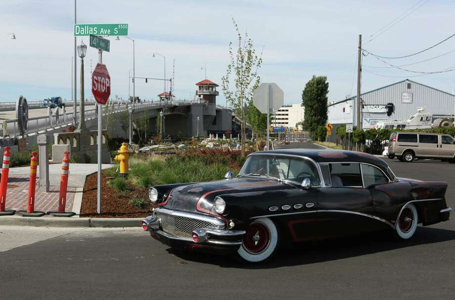 Now:The new 16th Avenue South Bridge is shown as a classic car drives by in Seattle's South Park neighborhood. Photo: JOSHUA TRUJILLO, SEATTLEPI.COM / SEATTLEPI.COM