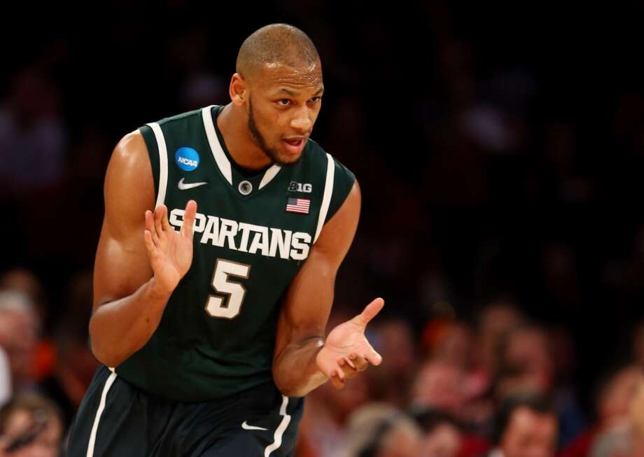 13. Minnesota – Adreian Payne, 6-10, F, Michigan State  It is often a mistake to forecast picks based on need, but Payne does make sense as Kevin Love's eventual successor. Photo: Elsa, Getty Images