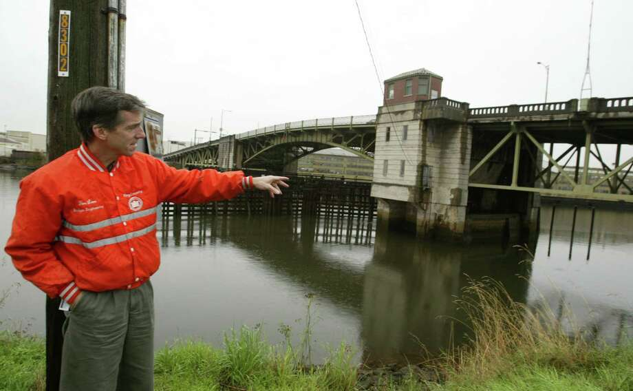 Then: King Country Bridge engineer Tim Lane points out some of the problems with the deteriorating old South Park Bridge. The bridge carried 20,000 vehicles daily across the Duwamish. Photo by Scott Eklund Photo: FILE PHOTO, SEATTLEPI.COM / SEATTLEPI.COM