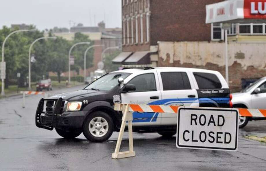 North Main Street in Mechanicville remained closed Thursday morning after a burst pipe and flood waters from Wednesday's heavy rains soaked the city. (Skip Dickstein / Times Union)