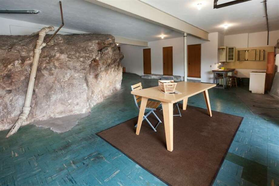 The home is designed around its giant boulders. This one is in the garage. Photo: MLS