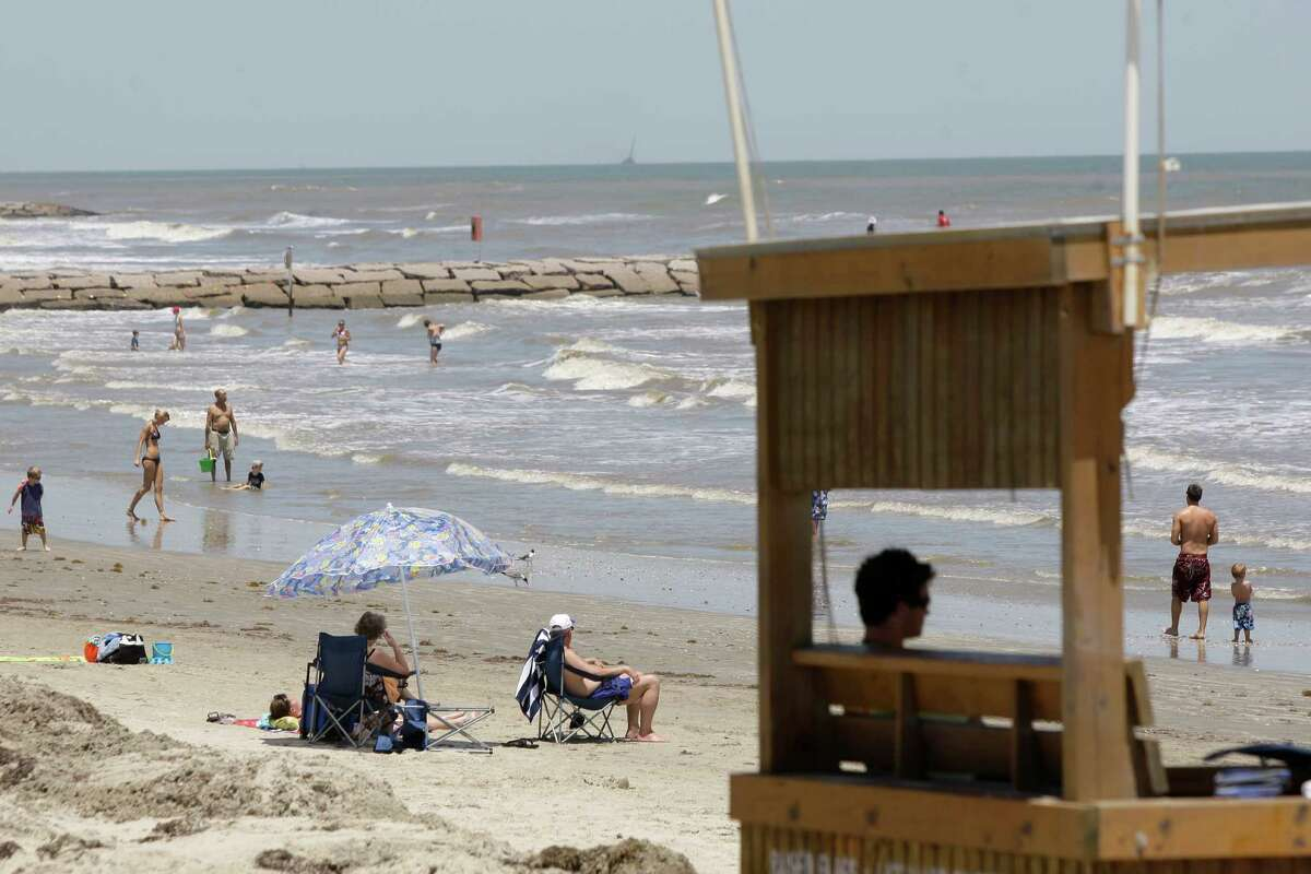 File photo from Ma 2011 shows a senior lifeguard keeping watch from a lifeguard station at 61st Street and Seawall Boulevard in Galveston.