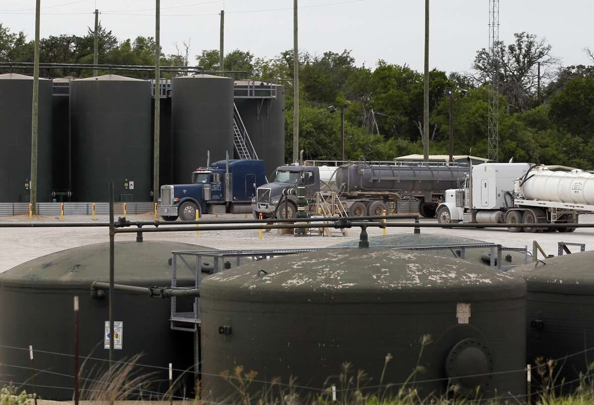 Tractor trailer trucks line up at an XTO Energy Inc. well site waiting to dump their fluid contents into a holding tank in Azle, Texas. Earthquakes used to be unheard of on the vast stretches of prairie that unroll across Texas and Oklahoma. But in recent years, temblors have become commonplace.