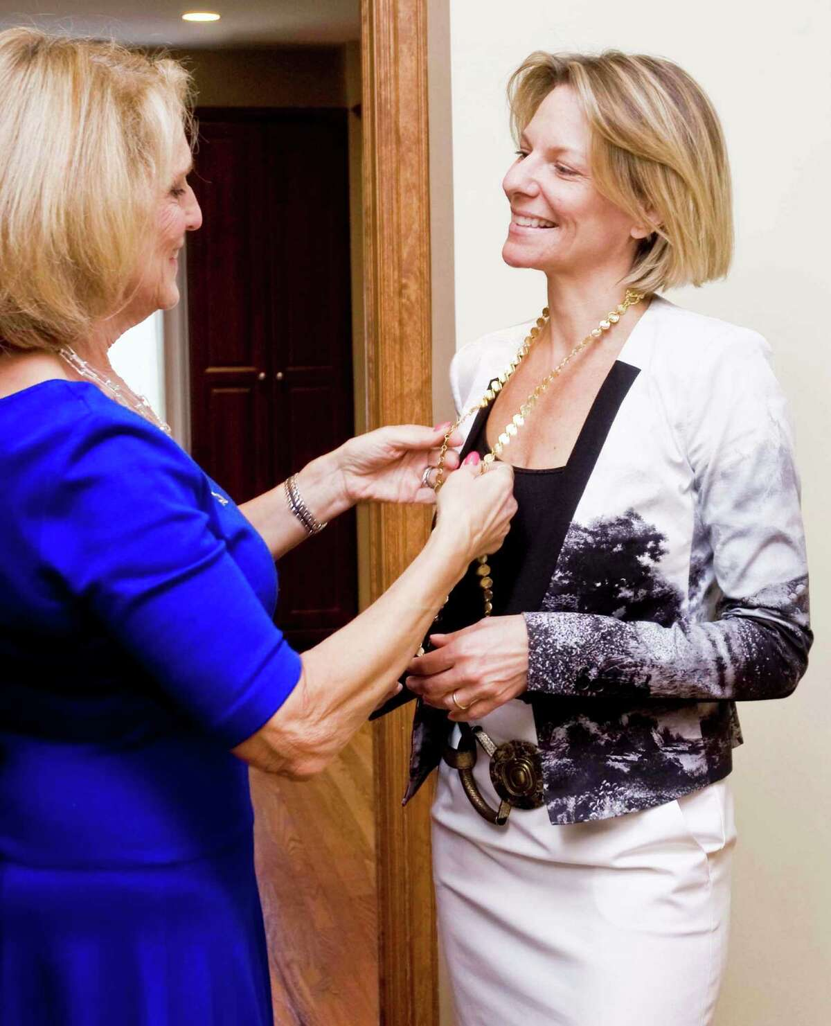 Image consultant and Danbury resident Pam Friedlander, owner of Positive Reflections, helps Ridgefield resident Lisa Jones choose the right clothes and accessories to look and feel her best, at Lisa's home in Ridgefield. Wednesday, June 25, 2014