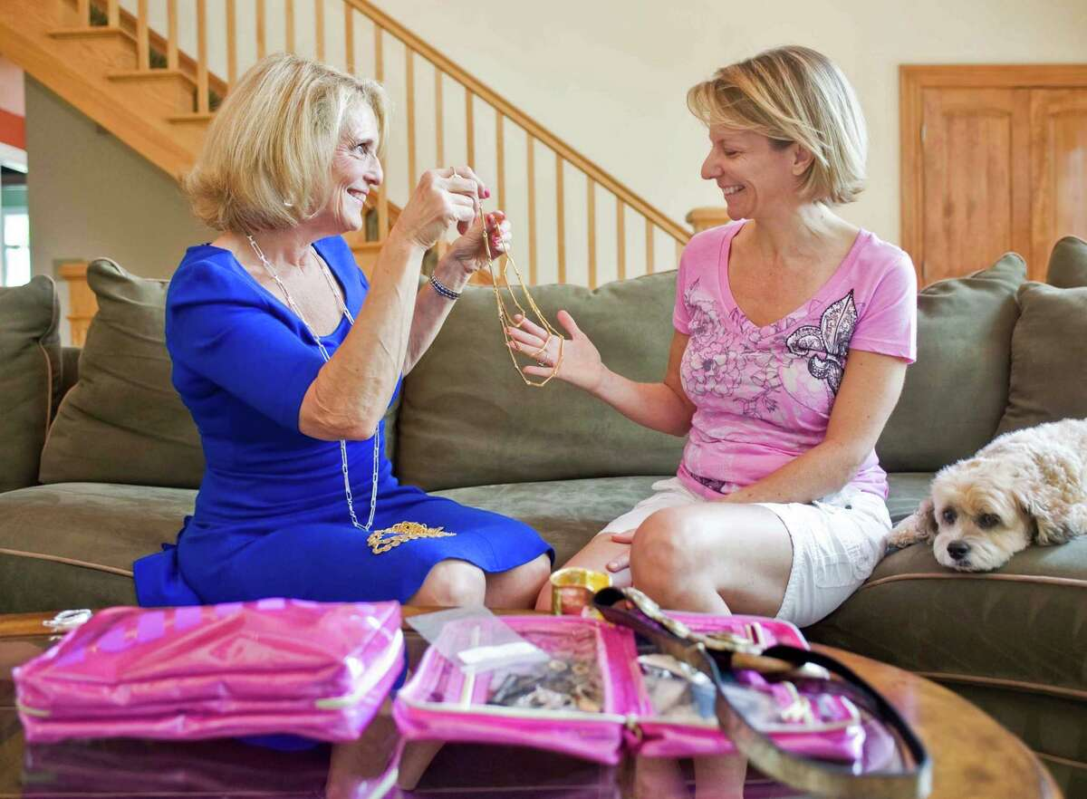 Image consultant and Danbury resident Pam Friedlander, owner of Positive Reflections, helps Ridgefield resident Lisa Jones choose the right accessories to look and feel her best, at Lisa's home in Ridgefield. Wednesday, June 25, 2014