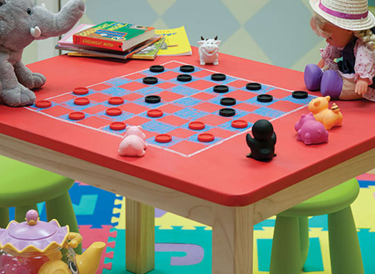 A child-size table painted with chalkboard paint can be turned into a table for games and activities.