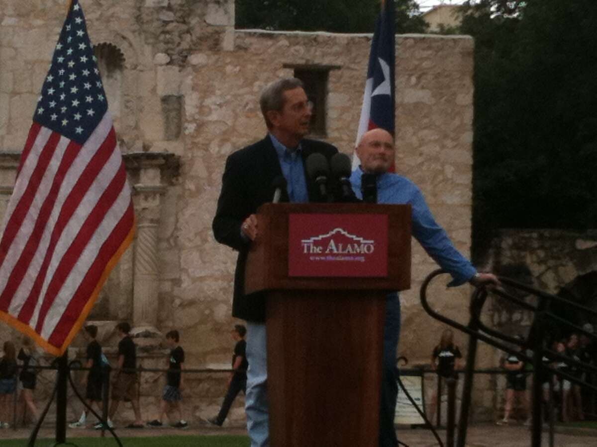 The presentation begins as Phil Collins prepares to present his artifacts collection to the Alamo.