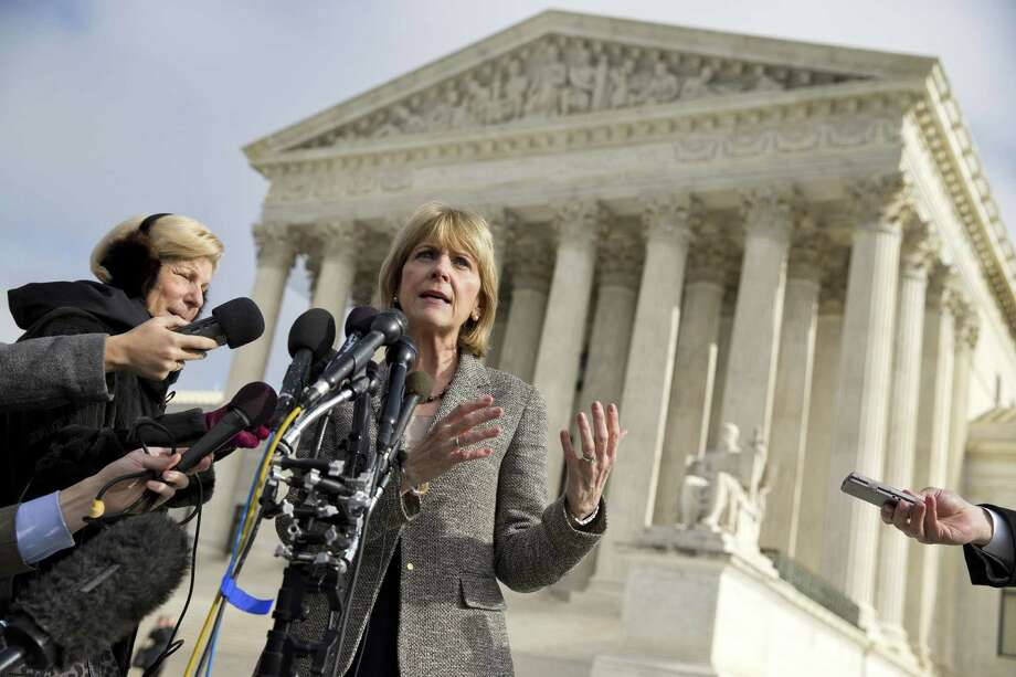 Massachusetts Attorney General Martha Coakley speaks to reporters outside the Supreme Court in Washington after a court hearing on a Massachusetts law setting a 35-foot protest-free zone outside abortion clinics. Photo: Evan Vucci / Associated Press / AP