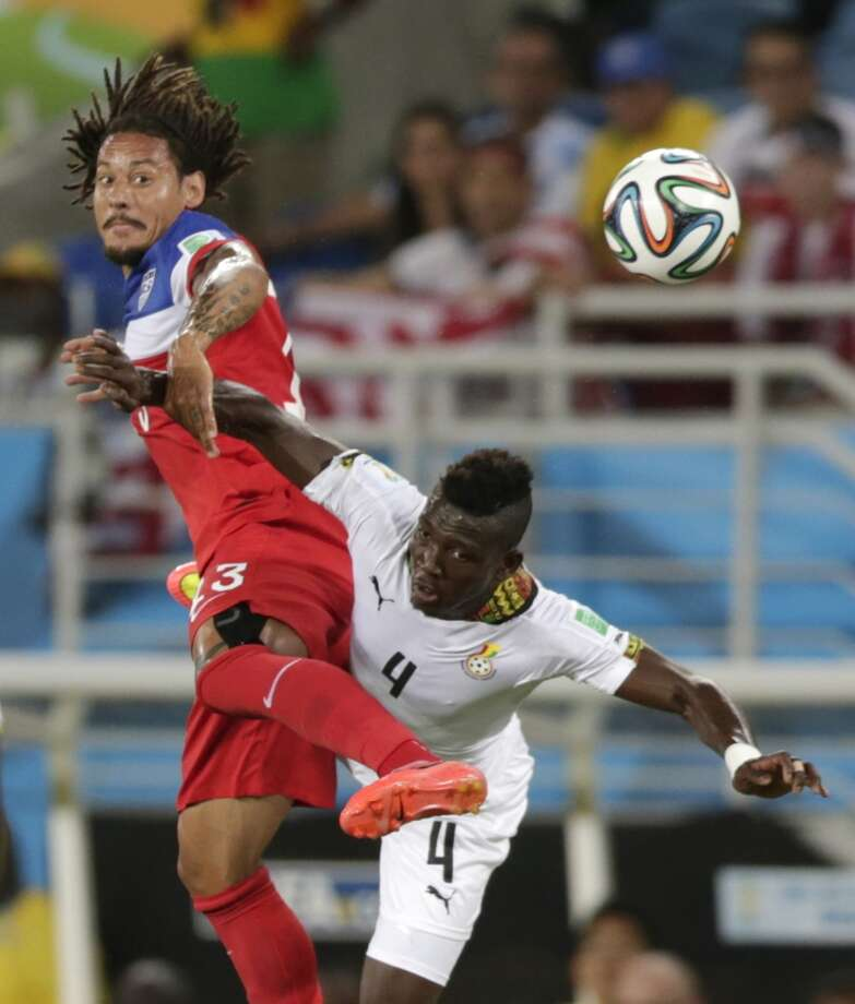 United States' Jermaine Jones, left, battles for the ball with Ghana's Daniel Opare during the group G World Cup soccer match between Ghana and the United States at the Arena das Dunas in Natal, Brazil, Monday, June 16, 2014.  (AP Photo/Dolores Ochoa) Photo: Dolores Ochoa, Associated Press