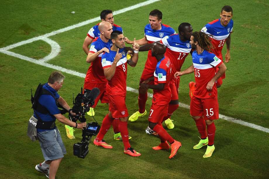 Clint Dempsey of the United States celebrates with teammates after scoring his team's first goal during the 2014 FIFA World Cup Brazil Group G match between Ghana and the United States at Estadio das Dunas on June 16, 2014 in Natal, Brazil.  (Photo by Laurence Griffiths/Getty Images) Photo: Laurence Griffiths, Getty Images
