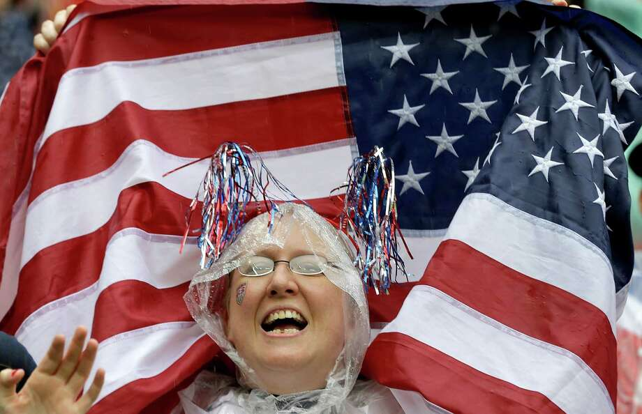 A USA national team supporter cheers before the group G World Cup soccer match between the United States and Germany at the Arena Pernambuco in Recife, Brazil, Thursday, June 26, 2014. (AP Photo/Julio Cortez) Photo: Julio Cortez, Associated Press / AP