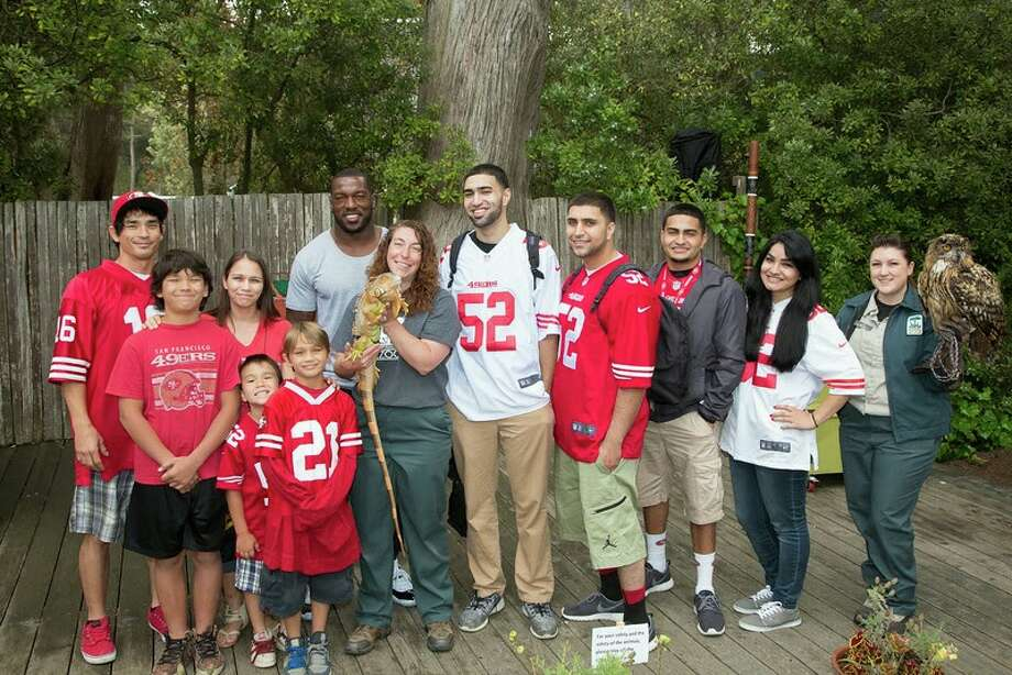 "San Francisco 49ers linebacker Patrick Willis poses with the winners of the Day at the Zoo contest at San Francisco Zoo on Wednesday, June 25, 2014. Photo: Marianne Hale, San Francisco Zoo / ""Pacifica Arts, Inc."""