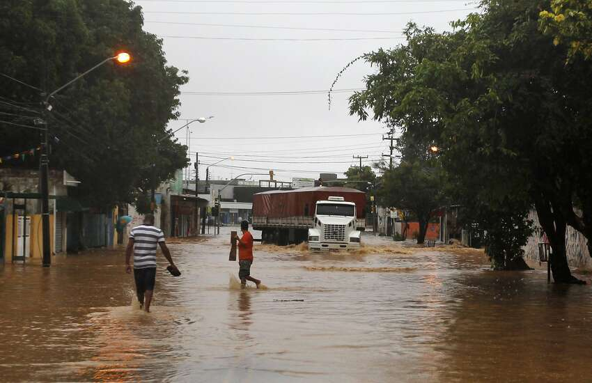 A truck makes its way down a flooded street after heavy rain storms in Recife, Brazil, Thursday, June 26, 2014.