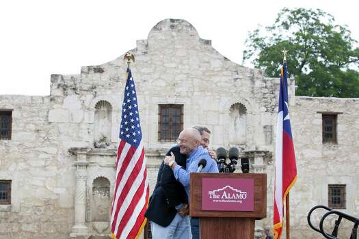 Texas Land Commissioner Jerry Patterson and singer Phil Collins hug during opening remarks Thursday June 26, 2014, in front of the Alamo. Collins is donating his personal Texas Revolution-era artifacts collection to the Alamo. Collins says he was always fascinated with the Alamo, even as a child, and hopes his collection can better tell the history of the Alamo and San Antonio. The collection is expected to be displayed within a year. Photo: Julysa Sosa For The Express-News, San Antonio Express-News / © 2013 San Antonio Express-News