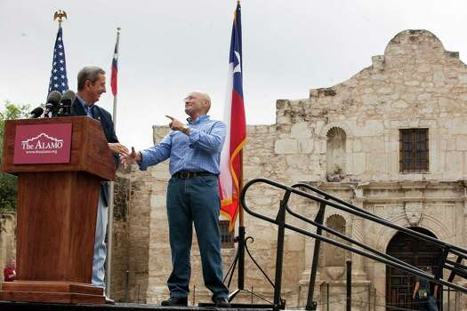 Texas Land Commissioner Jerry Patterson greets singer Phil Collins during opening remarks Thursday June 26, 2014, in front of the Alamo. Collins is donating his personal Texas Revolution-era artifacts collection to the state. Collins says he was always fascinated with the Alamo, even as a child, and hopes his collection can better tell the history of the Alamo and San Antonio. The collection is expected to be displayed within a year. Photo: Julysa Sosa For The Express-News, San Antonio Express-News / © 2013 San Antonio Express-News