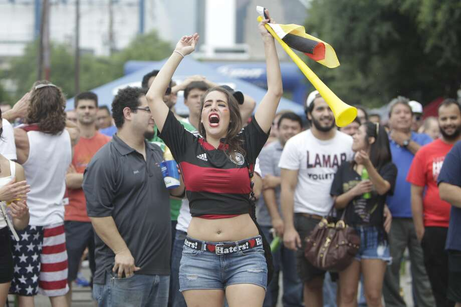 The lone Germany fan cheers for Germany's goal as fans gather at Lucky's Pub to the view the USA vs Germany World Cup game on June 26, 2014 in Houston. (Mayra Beltran / Houston Chronicle) Photo: Mayra Beltran, Houston Chronicle