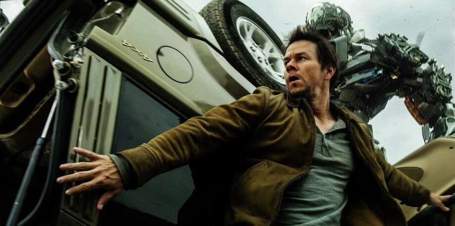 """Mark Wahlberg stars as Cade Yeager, who is on the run from bad-guy Decepticon Lockdown, in """"Transformers: Age of Extinction."""" Photo: Photo Credit: Industrial Light &, E74-VFX-015 / © 2014 Paramount Pictures. All Rights Reserved. HASBRO, TRANSFORMERS, and all related characters are trademarks of Hasbro. © 2"""