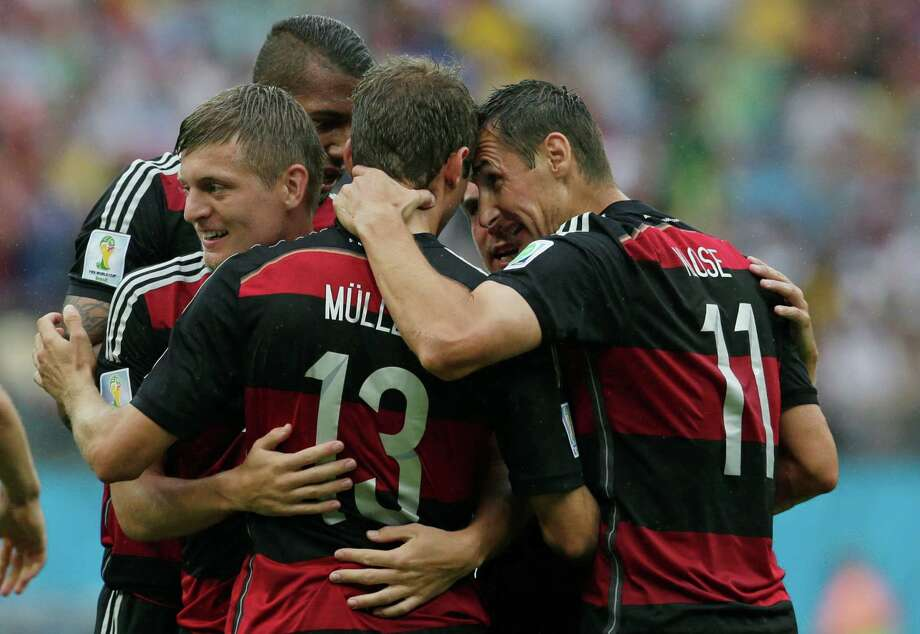 Germany's Miroslav Klose, right, congratulates Thomas Mueller after he scored the opening goal during the group G World Cup soccer match between the USA and Germany at the Arena Pernambuco in Recife, Brazil, Thursday, June 26, 2014. (AP Photo/Petr David Josek) Photo: Petr David Josek, Associated Press / AP