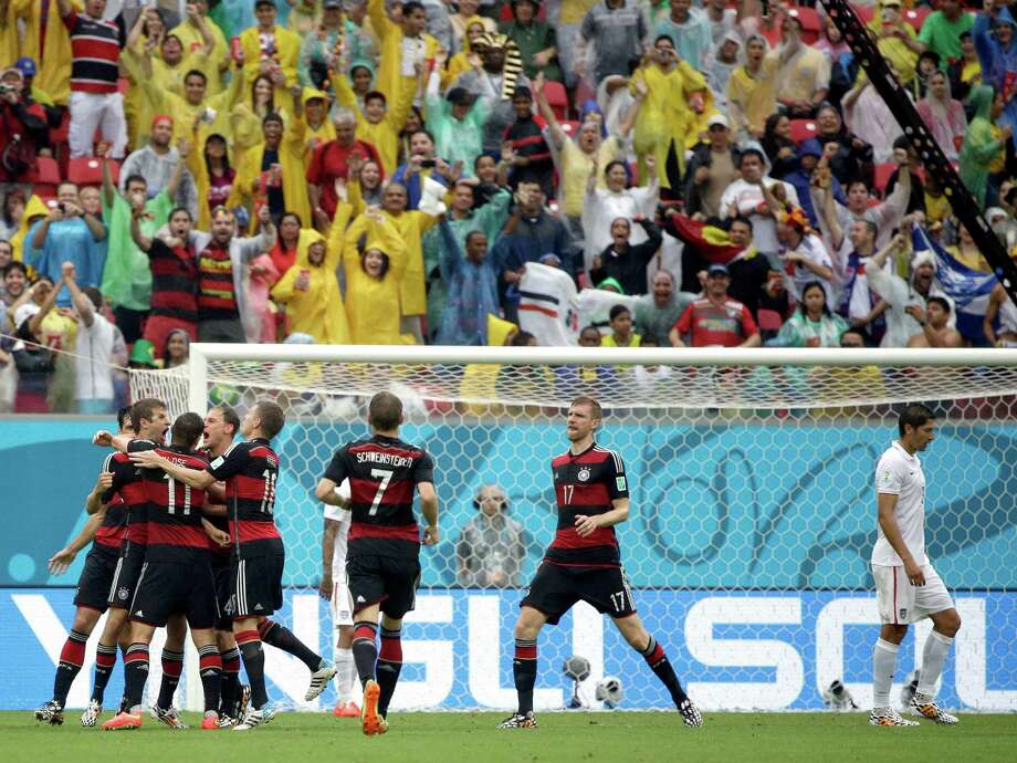 Germany's Thomas Mueller, left, celebrates with his teammates after scoring his side's first goal during the group G World Cup soccer match between the United States and Germany at the Arena Pernambuco in Recife, Brazil, Thursday, June 26, 2014. (AP Photo/Ricardo Mazalan) Photo: Ricardo Mazalan, Associated Press / AP