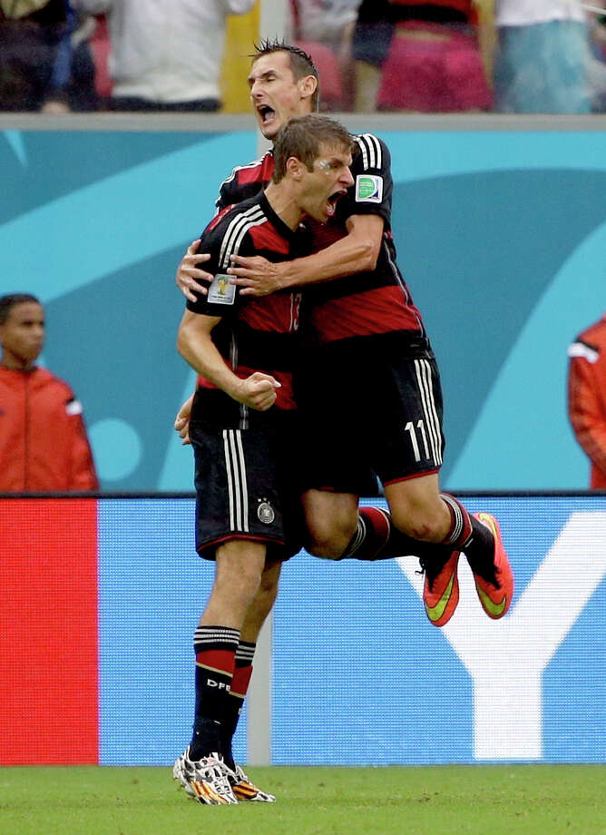 Germany's Thomas Mueller celebrates with his teammate Miroslav Klose after scoring his side's first goal during the group G World Cup soccer match between the United States and Germany at the Arena Pernambuco in Recife, Brazil, Thursday, June 26, 2014.  (AP Photo/Ricardo Mazalan) Photo: Ricardo Mazalan, Associated Press / AP
