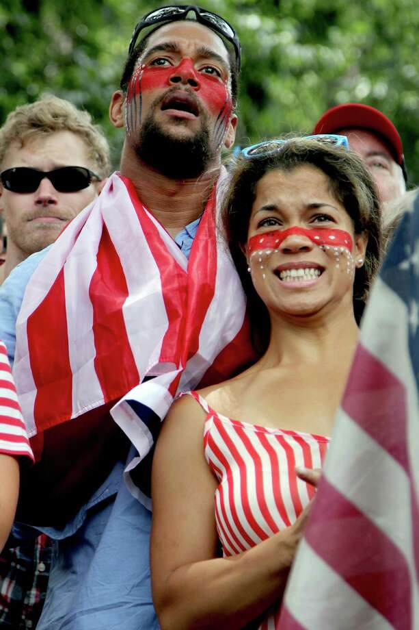 Francesca Andrea, 25, and Gordon Richardson, 35, of Washington, grimace while watching the US-Germany World Cup soccer match, Thursday, June 26, 2014, during a viewing party sponsored by the German Embassy Thursday, June 26, 2014,  in Dupont Circle in Washington. (AP Photo/Connor Radnovich) Photo: Connor Radnovich, Associated Press / AP