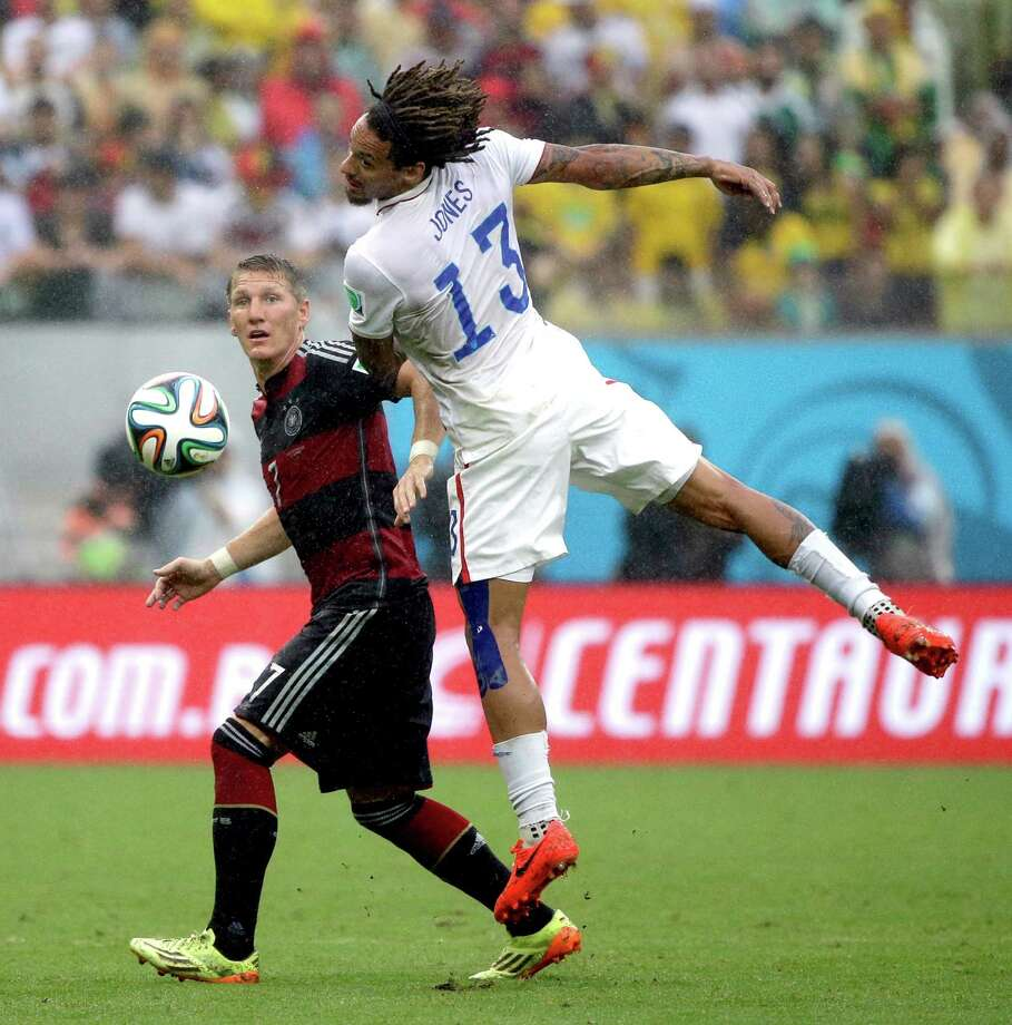 United States' Jermaine Jones heads the ball away from Germany's Bastian Schweinsteiger during the group G World Cup soccer match between the USA and Germany at the Arena Pernambuco in Recife, Brazil, Thursday, June 26, 2014. (AP Photo/Ricardo Mazalan) Photo: Ricardo Mazalan, Associated Press / AP
