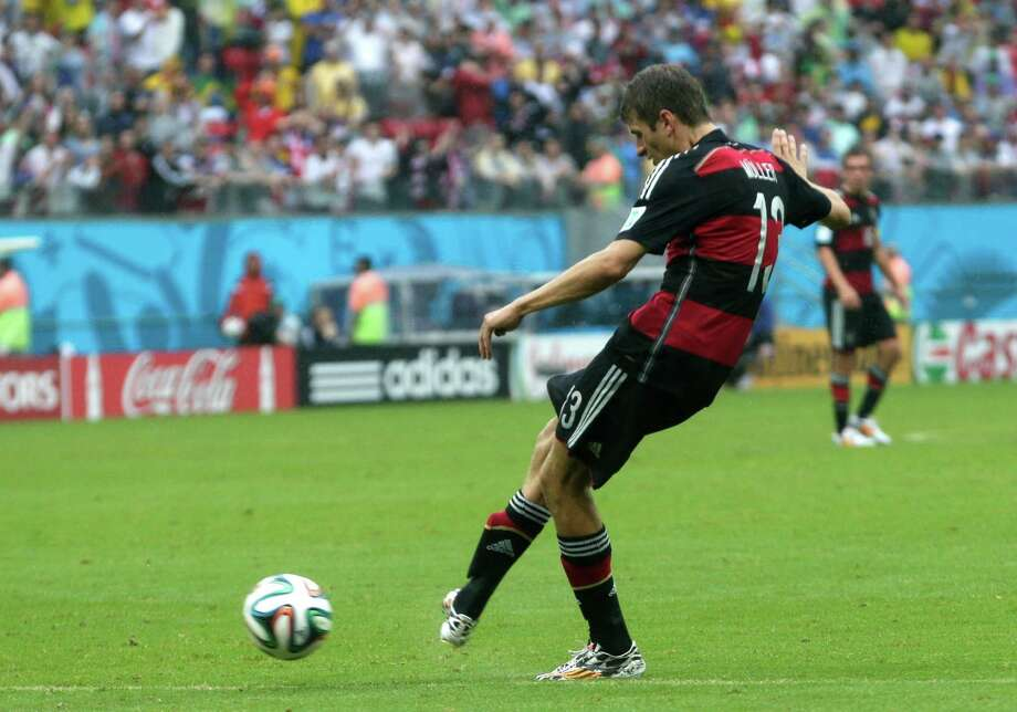 Germany's Thomas Mueller scores the opening goal during the group G World Cup soccer match between the USA and Germany at the Arena Pernambuco in Recife, Brazil, Thursday, June 26, 2014. (AP Photo/Petr David Josek) Photo: Petr David Josek, Associated Press / AP