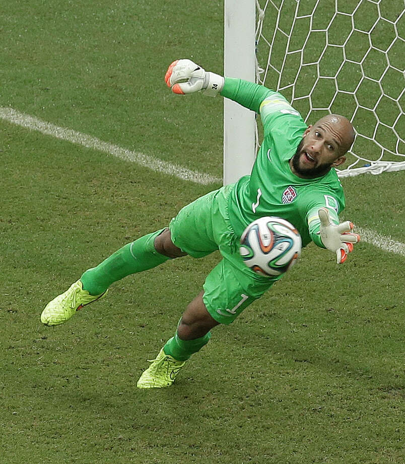 United States' goalkeeper Tim Howard can't stop a shot by Germany's Thomas Mueller during the group G World Cup soccer match between the USA and Germany at the Arena Pernambuco in Recife, Brazil, Thursday, June 26, 2014. Mueller scored on the play. (AP Photo/Hassan Ammar) Photo: Hassan Ammar, Associated Press / AP