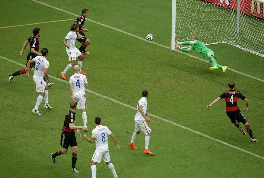 United States' goalkeeper Tim Howard blocks a shot by during the group G World Cup soccer match between the USA and Germany at the Arena Pernambuco in Recife, Brazil, Thursday, June 26, 2014. (AP Photo/Hassan Ammar) Photo: Hassan Ammar, Associated Press / AP