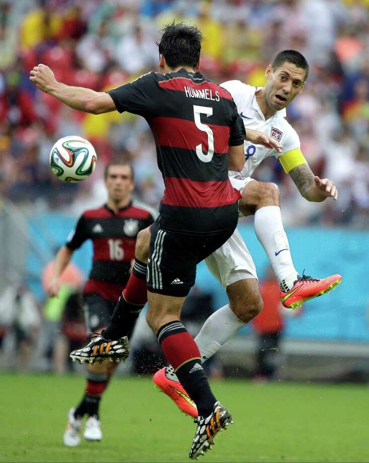 United States' Clint Dempsey is defended by Germany's Mats Hummels during the group G World Cup soccer match between the USA and Germany at the Arena Pernambuco in Recife, Brazil, Thursday, June 26, 2014. (AP Photo/Ricardo Mazalan) Photo: Ricardo Mazalan, Associated Press / AP