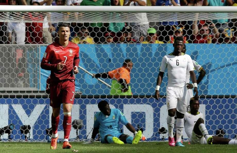 June 26Portugal 2, Ghana 1 Photo: Martin Mejia, Associated Press / AP