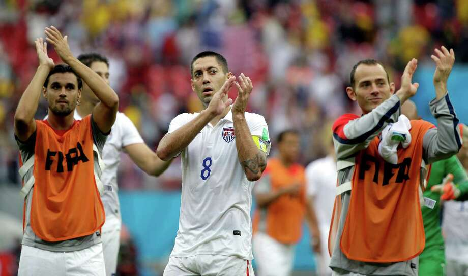 United States' Clint Dempsey, center, and his teammates applaud after qualifying for the next World Cup round following their 1-0 loss to Germany during the group G World Cup soccer match between the USA and Germany at the Arena Pernambuco in Recife, Brazil, Thursday, June 26, 2014. (AP Photo/Ricardo Mazalan) Photo: Ricardo Mazalan, Associated Press / AP