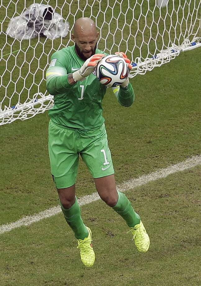 United States' goalkeeper Tim Howard makes a save during the group G World Cup soccer match between the USA and Germany at the Arena Pernambuco in Recife, Brazil, Thursday, June 26, 2014. (AP Photo/Hassan Ammar) Photo: Associated Press