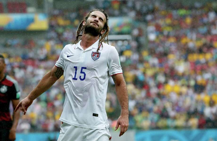 United States' Kyle Beckerman closes his eyes during the group G World Cup soccer match between the USA and Germany at the Arena Pernambuco in Recife, Brazil, Thursday, June 26, 2014. (AP Photo/Matthias Schrader) Photo: Matthias Schrader, Associated Press / AP