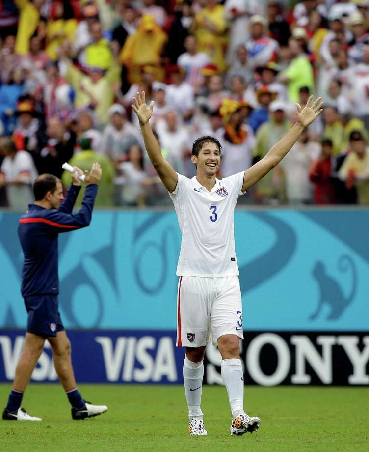United States' Omar Gonzalez celebrates after qualifying for the next World Cup round following their 1-0 loss to Germany during the group G World Cup soccer match between the USA and Germany at the Arena Pernambuco in Recife, Brazil, Thursday, June 26, 2014. (AP Photo/Ricardo Mazalan) Photo: Ricardo Mazalan, Associated Press / AP