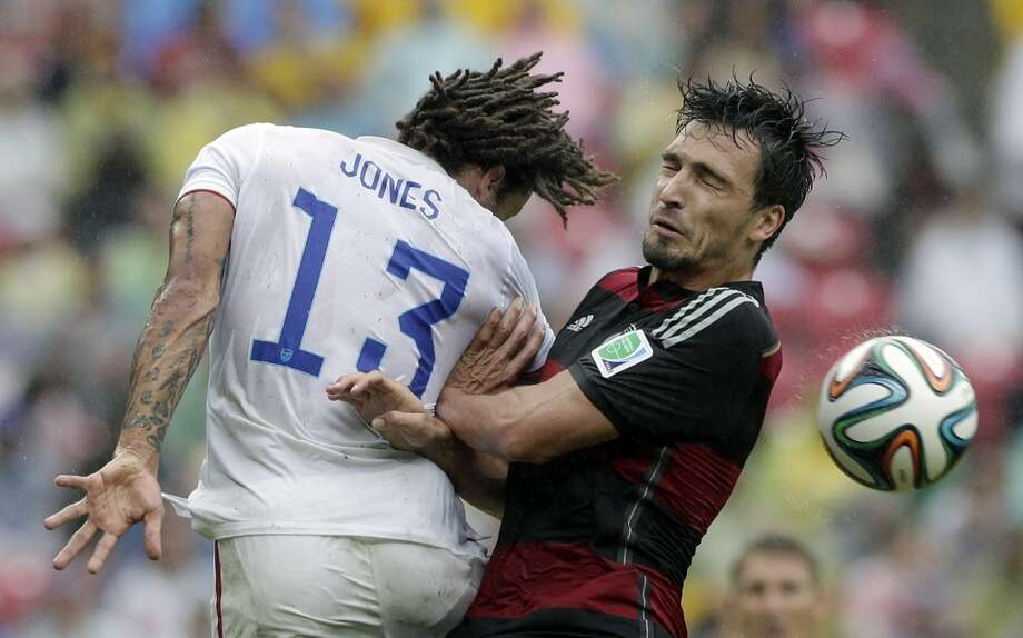 Germany's Mats Hummels, right, and United States' Jermaine Jones go for a header during the group G World Cup soccer match between the USA and Germany at the Arena Pernambuco in Recife, Brazil, Thursday, June 26, 2014. (AP Photo/Matthias Schrader) Photo: Associated Press
