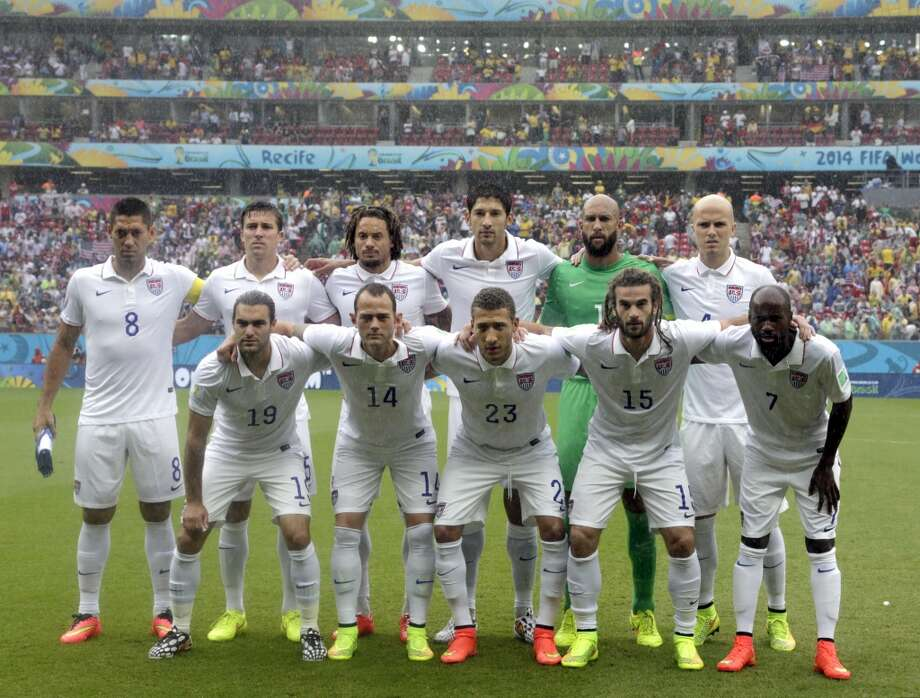 The USA national team pose before the group G World Cup soccer match between the United States and Germany at the Arena Pernambuco in Recife, Brazil, Thursday, June 26, 2014. (AP Photo/Julio Cortez) Photo: Julio Cortez, Associated Press