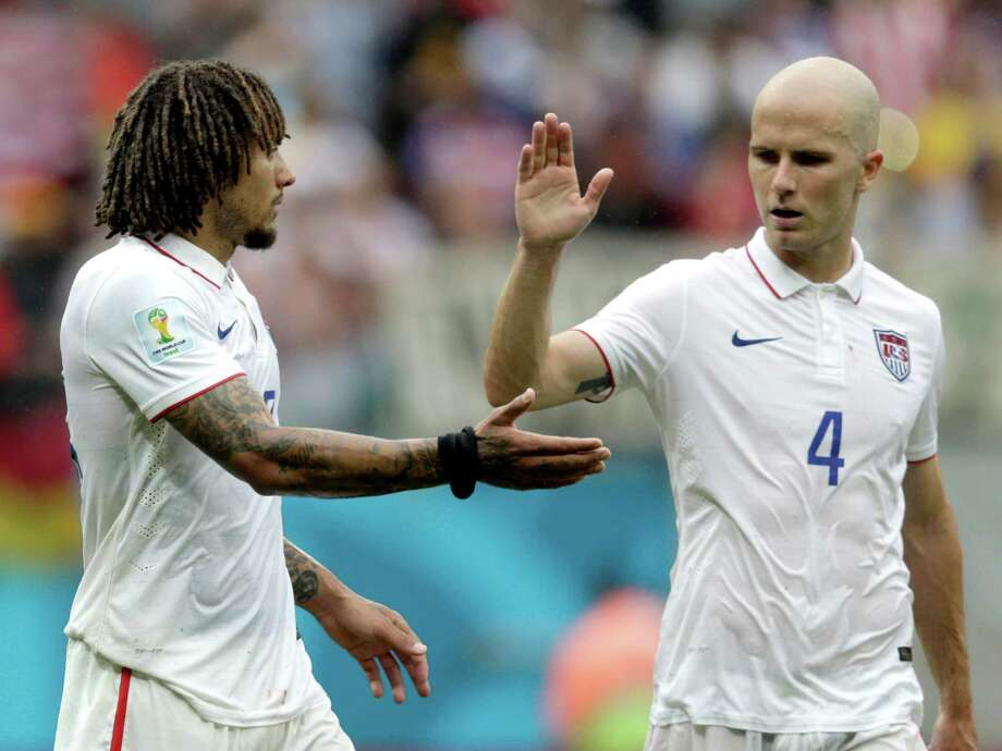 United States' Michael Bradley, right, congratulates his teammate Jermaine Jones after qualifying for the next World Cup round following their 1-0 loss to Germany during the group G World Cup soccer match between the USA and Germany at the Arena Pernambuco in Recife, Brazil, Thursday, June 26, 2014. (AP Photo/Julio Cortez) Photo: Julio Cortez, Associated Press / AP