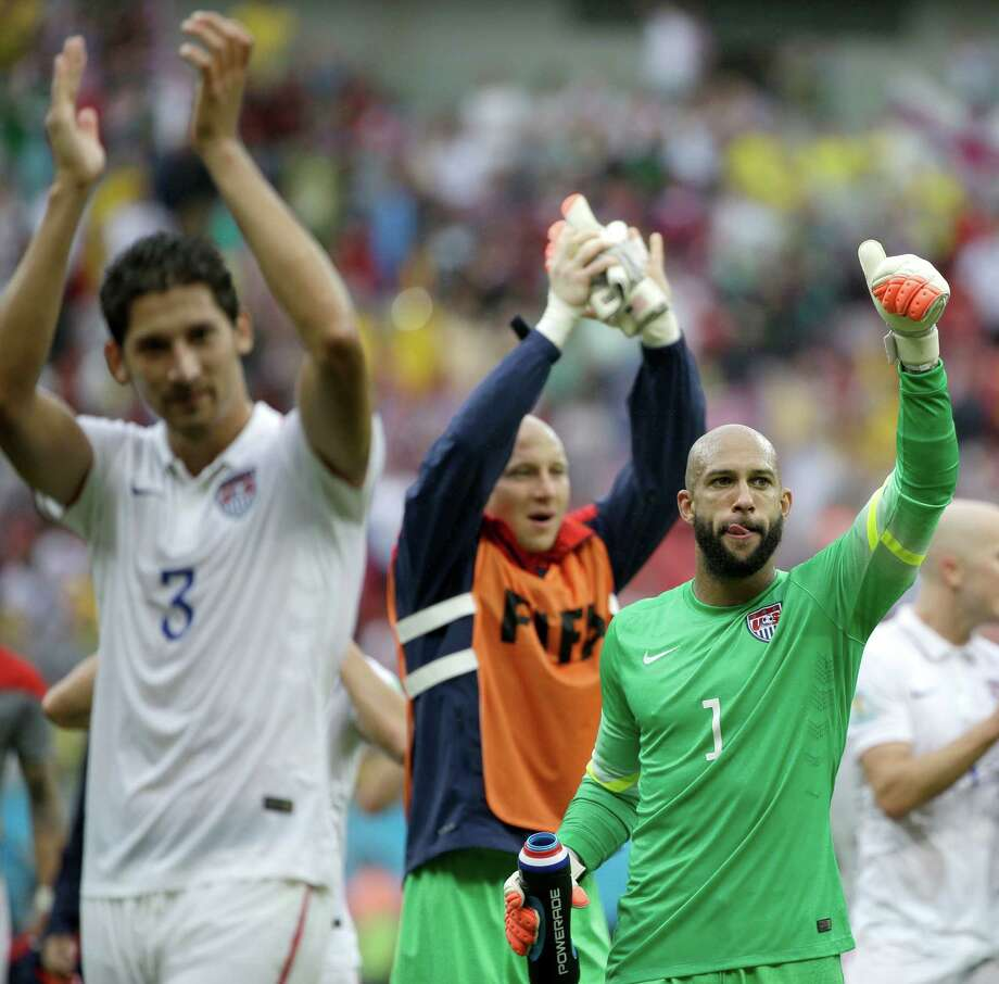 United States' goalkeeper Tim Howard (1) and his teammates celebrate after qualifying for the next World Cup round following their 1-0 loss to Germany during the group G World Cup soccer match between the USA and Germany at the Arena Pernambuco in Recife, Brazil, Thursday, June 26, 2014. (AP Photo/Ricardo Mazalan) Photo: Ricardo Mazalan, Associated Press / AP