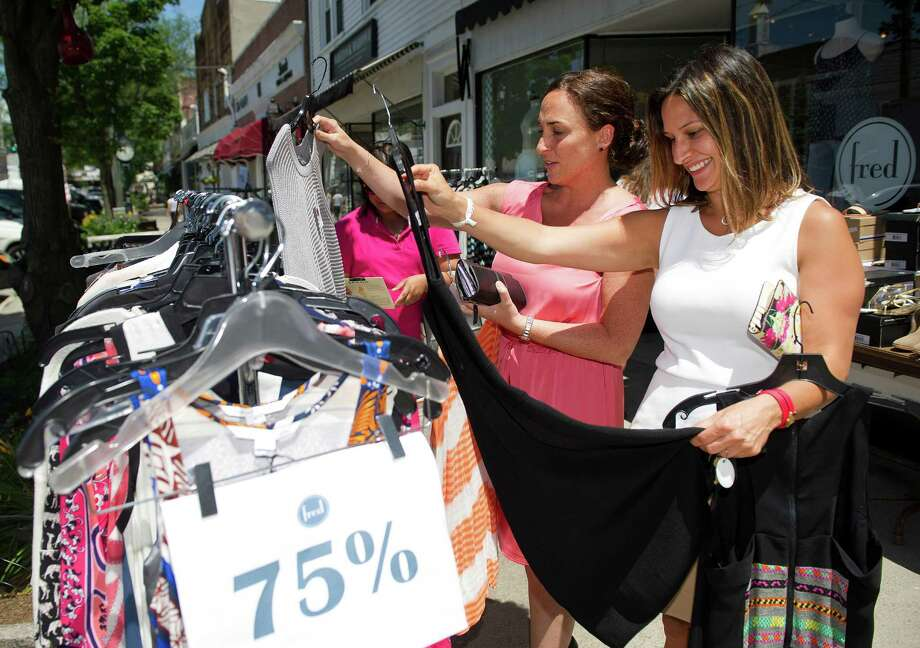 Sarah Bunnell, right, and Lauren Gradante, left, shop at Fred during the Old Greenwich Merchants Sidewalk Sale on Sound Beach Ave. in Greenwich, Conn., on Thursday, June 26, 2014. Photo: Lindsay Perry / Stamford Advocate