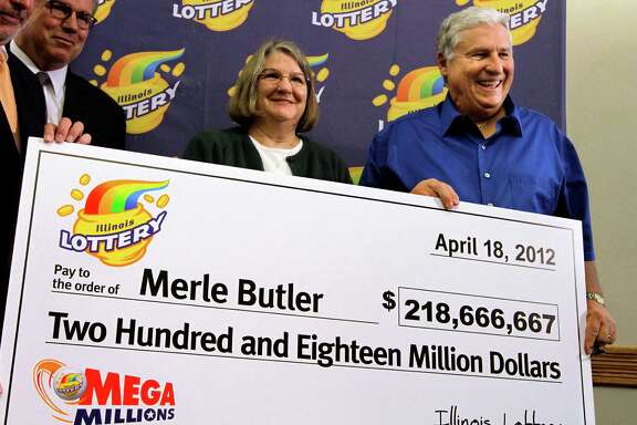 Merle and Patricia Butler, of Red Bud, Ill., pose with a novelty check during a news conference at the Red Bud Village Hall on Wednesday, April 18, 2012 in Red Bud, Ill. The retired southern Illinois couple has claimed the third and final share of last month's record $656 million Mega Millions jackpot. (AP Photo/Seth Perlman)