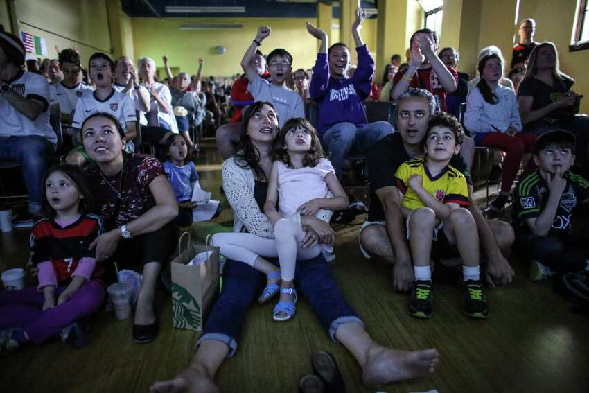 Fans gather during a World Cup watching party at the Phinney Community Center as the US takes on Germany. Hundreds gathered for the World Cup watching party on Thursday, June 26, 2014. The US fell to Germany, 1-0, but advanced in the tournament.