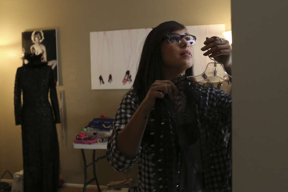 Designer Samantha Plasencia puts the finishing touches on the collection she'll be showing at Mercedes-Benz Fashion Week in New York, at her home in San Antonio on Thursday, Jan. 31, 2013. Photo: San Antonio Express-News
