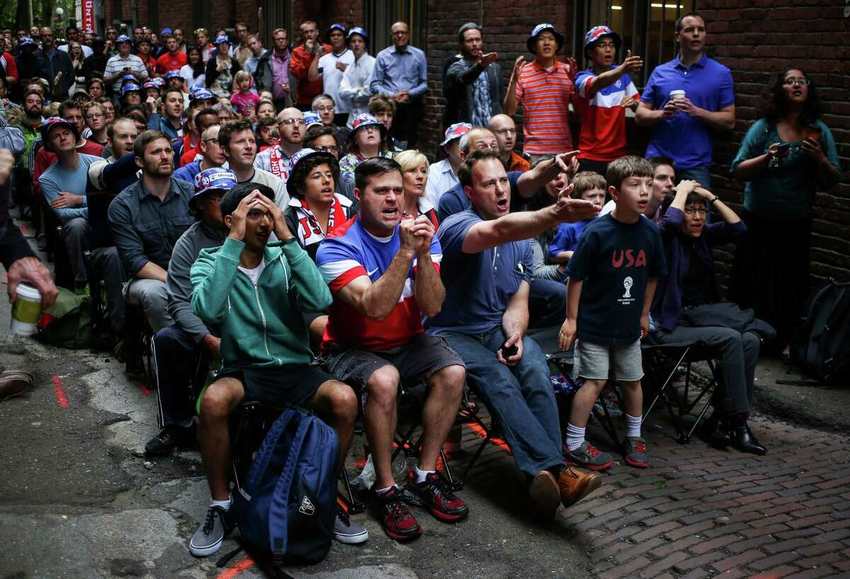 Fans react to a missed opportunity by the United States during a World Cup viewing party in Nord Alley in Pioneer Square.