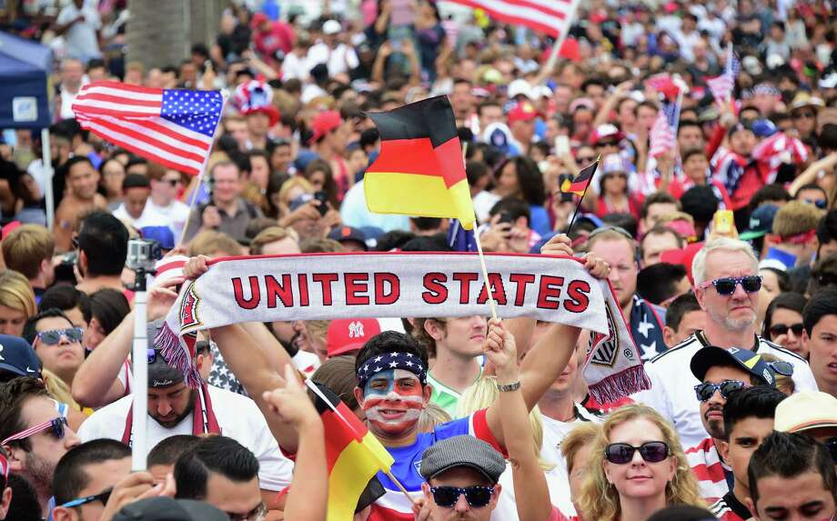US fans show their support while gathered to watch off a big screen at Hermosa Beach, California on June 26, 2014, asThomas Muller scored the lone goal for Germany in a 1-0 win over the United States during their final first round match at the FIFA 2014 World Cup in Brazil. The USA were helped through by  Portugal's 2-1 victory over Ghana.  AFP PHOTO/Frederic J. BROWNFREDERIC J. BROWN/AFP/Getty Images Photo: FREDERIC J. BROWN, AFP/Getty Images / AFP