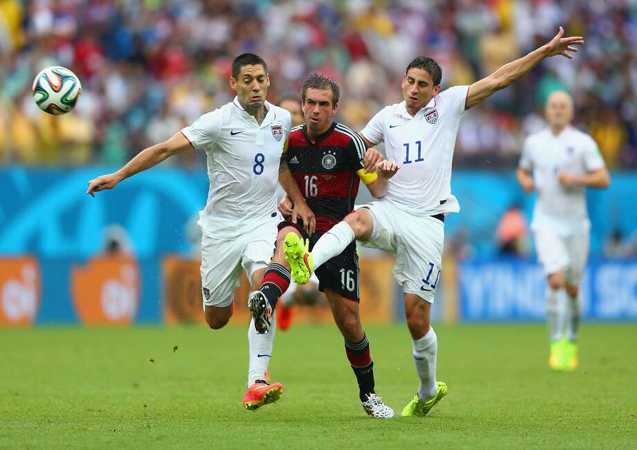 Philipp Lahm of Germany is challenged by Clint Dempsey (L) and Alejandro Bedoya of the United States during the 2014 FIFA World Cup Brazil group G match between the United States and Germany at Arena Pernambuco on June 26, 2014 in Recife, Brazil.  Photo: Michael Steele, Getty Images
