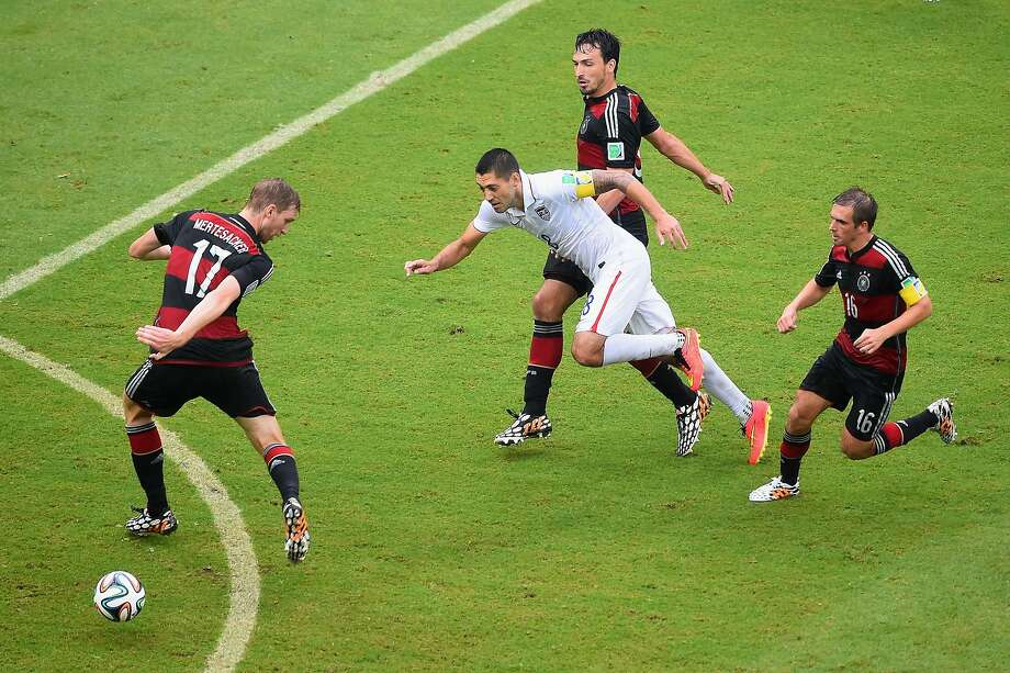 Clint Dempsey of the United States competes for the ball with Per Mertesacker (L), Mats Hummels (2nd R) and Philipp Lahm of Germany during the 2014 FIFA World Cup Brazil group G match between the United States and Germany at Arena Pernambuco on June 26, 2014 in Recife, Brazil. Photo: Laurence Griffiths, Getty Images