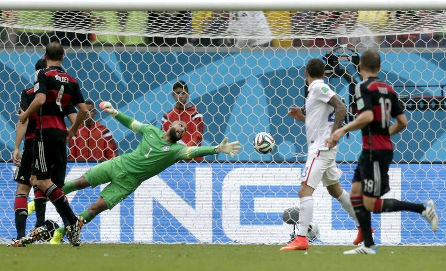 United States' goalkeeper Tim Howard can not stop a shot by Germany's Thomas Mueller to score his side's first goal during the group G World Cup soccer match between the United States and Germany at the Arena Pernambuco in Recife, Brazil, Thursday, June 26, 2014. Photo: Julio Cortez, Associated Press