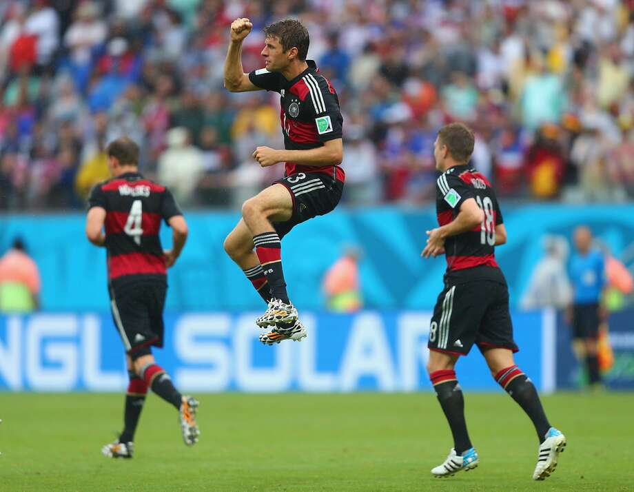 Thomas Mueller of Germany (C) celebrates scoring his team's first goal during the 2014 FIFA World Cup Brazil group G match between the United States and Germany at Arena Pernambuco on June 26, 2014 in Recife, Brazil. Photo: Martin Rose, Getty Images