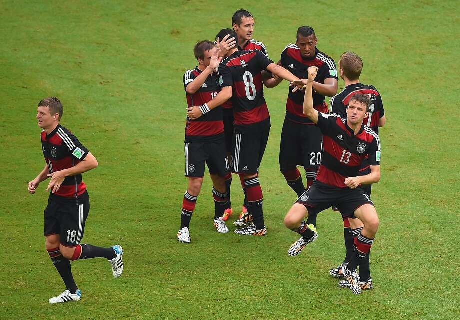 Thomas Mueller of Germany (R) celebrates scoring his team's first goal with teammates during the 2014 FIFA World Cup Brazil group G match between the United States and Germany at Arena Pernambuco on June 26, 2014 in Recife, Brazil. Photo: Laurence Griffiths, Getty Images